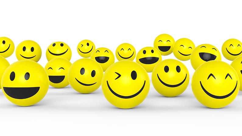runda gula bollar med leende och skrattande smajlisgubbar